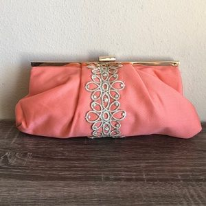 Coral embroidered mud pie clutch